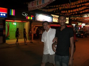 Mark Gilbore (standing on the right) gives Dale Asis (on the left) a tour of Angeles City's red light district with the infamous bar girls standing outside the bars (2011)