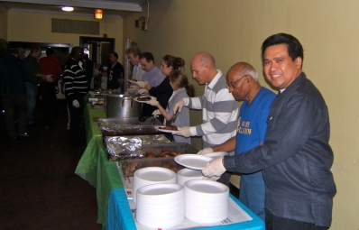 (far right) Dale Asis serving food to the homeless on Thanksgiving Day (Nov 24, 2011)