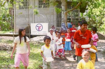 Filipino Muslim children enjoying feast during Eid al-Adha in Iligan, Mindanao, Pihlippines (2010 )