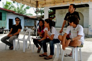 (standing far right) James Castlllo leads youth workshop in envrionmental conservation and renewal and in planting mangrove trees in Cebu, Philippines