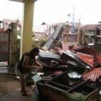 Evelyn Castillo, Bayanihan's Philippine Liaison, inspecting the remains of her home