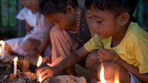 Philippines-children-lighting-candles-legacy-use-only_layout-large