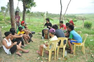Youth participate in song writing for environmental sustainability workshop