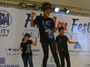 Members of the United Philippine Amerasians dancing and performing at SM City Clark Mall, Angeles City, Philippines