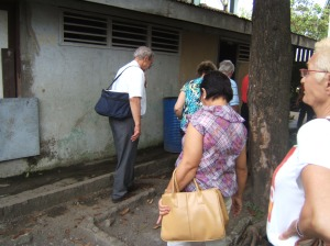 Rotarians from Rotary Chicago Far North visiting non-functioining latrines at Rotary Club Chicago Far North in 2012
