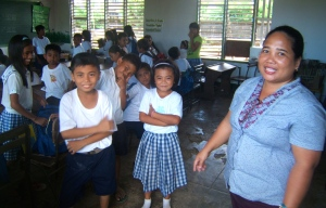 Marlefe Lo (standing far right) with her Fifth grade students of Giporlos Central School