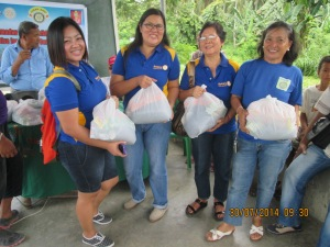 Members of Rotary Iligan East distributing food packages for needy Filipino Muslims