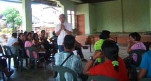 (standing in center) Mayor Jaime Ty of MacArthur, Eastern Samar conducts town hall meeting about the need for latrines and meeting 'zero open defacation' goals