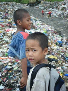 Street children picking scraps from a garbage dump in Tacloban City, Leyte Philippines (photo courtesy of Feeding A Future)