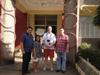Bayanihan Foundation visits Dr. Palabrica in the municipal hall (left to right): Dale Asis, Evelyn Castillo, Will Dix and Dr. Rufino Palabrica