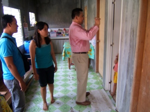 Homeowner Christine Panero (standing center)  shows her home to  Dane Dizon (standing left) and Dale Asis (standing right)