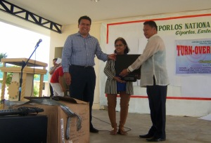 (left to right): Dale Asis and Evelyn Castillo of Bayanihan Foundation Worldwide donating computers to Benjamin Campomanes, Principal of Giporlos National Trade School