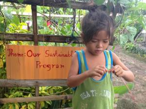 Young resident of LIloan Cebu, a fisher folk community supported by the Bayanihan Foundation since 2011.