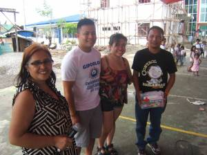 (left to right): Evelyn Castillo, Marc Butiong and Jeselle Santiago gives thank you certificate to Barangay (village) Captain of Parenas, Giporlos Samar