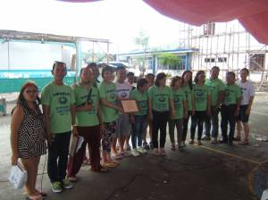 Evelyn Castillo and barangay (village) officials accpeting awards and certificates after the successful environmental clean up efforts there