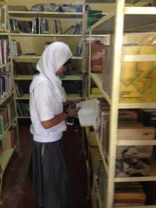Amedah Dimangadap enjoying one of the 1,000 titles of used books donated