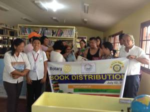 Members of the Rotary Iligan East helped with the distribution of the used books