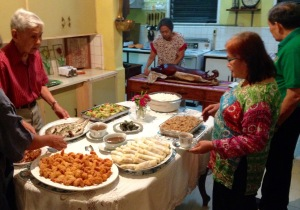 (left to right); Vicente Saavedra and Evelyn Castillo enjoying the spread of native foods and delicacies during the welcome dinner in Iligan City