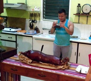 Marc Butiong taking picture of the lechon
