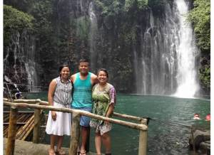 Jane Baron (standing left) poses with other NEXTGEN Fellows Marc Butiong and Jeselle Santiago in Tinago Falls, iligan