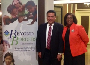 Dale Asis (standing left) attends the Beyond Borders International fundraiser with founder Sharon Charleston (standing right)