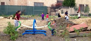 Children playing at the community garden hosted by the Little Village Environmental Justice Organization (LVEJO)