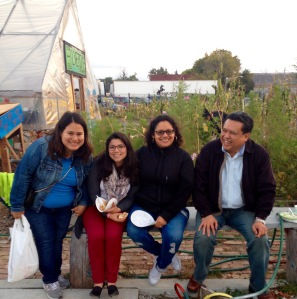 Dale Asis (sitting far right) joins the Little Village Environmental Justice Organization (LVEJO) staff and community members at their end-of-summer community dinner