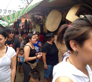NEXTGEN Fellow Jane Baron (center) walks through Cebu's Carbon Market, the island's oldest and largest public market