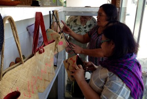 (left to right): Evelyn Castillo shopping for handmade purses and bags with Anacita Badaran, women leader of the Basey Women's Cooperative