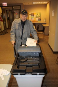 Mr. Dominador Ramirez, a WWII veteran, submits his ballot at the Philippine Consulate General Office in Chicago (photo courtesy of the Philippine Consulate General of Chicago)