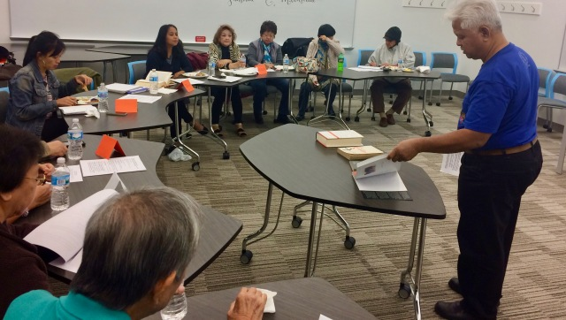 (standing far right): Eugene Asidao of Committee on Pilipino Issues gave a comprehensive review of Philippine history at DePaul University